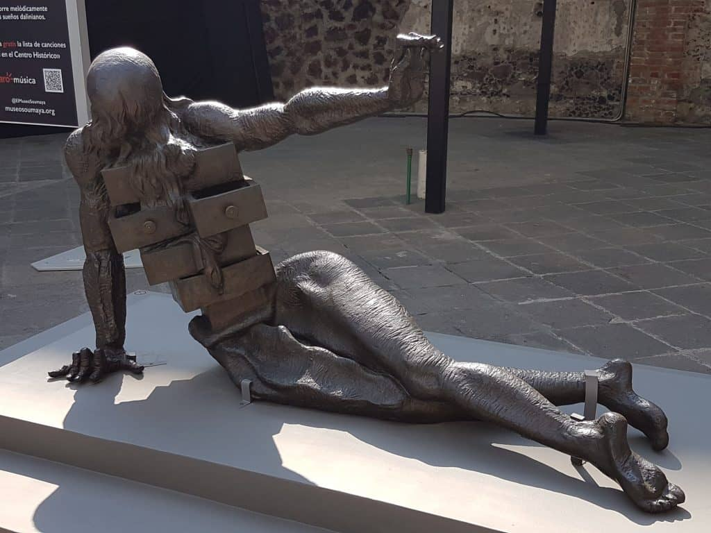 Sculpture in the Salvador Dali garden exhibit depicting man sitting with drawers in his chest