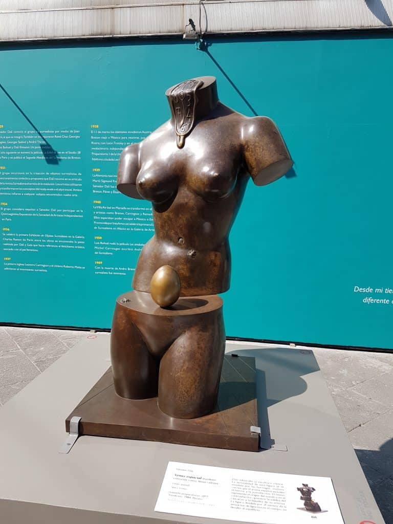 Sculpture in the Salvador Dali garden exhibit depicting separated torso