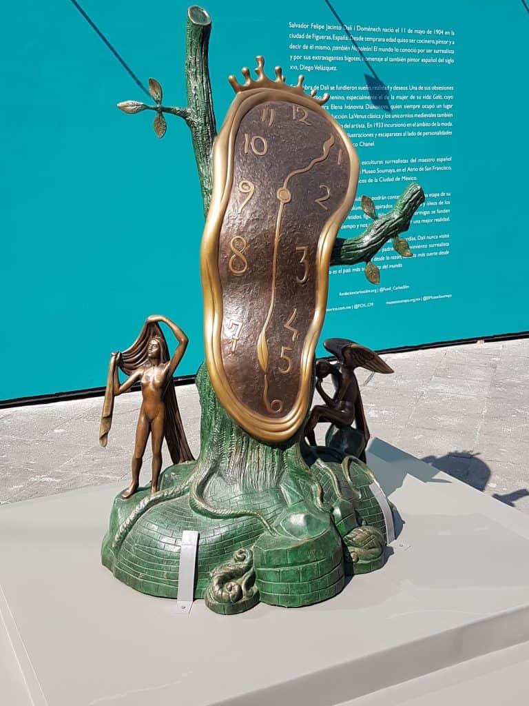 Sculpture in the Salvador Dali garden exhibit depicting a melting clock