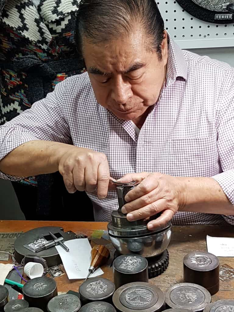 Silversmith Rafael carving silver in Mexico City