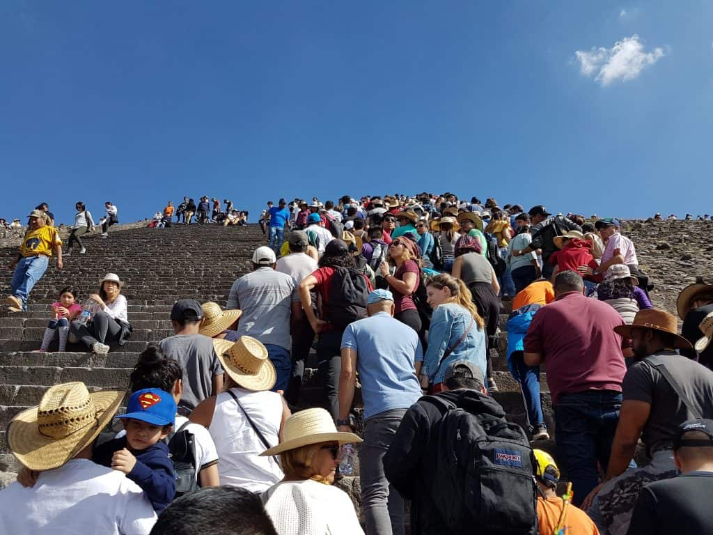 Crowd climbing the Pyramid of the Sun at Teotihuacan, Mexico