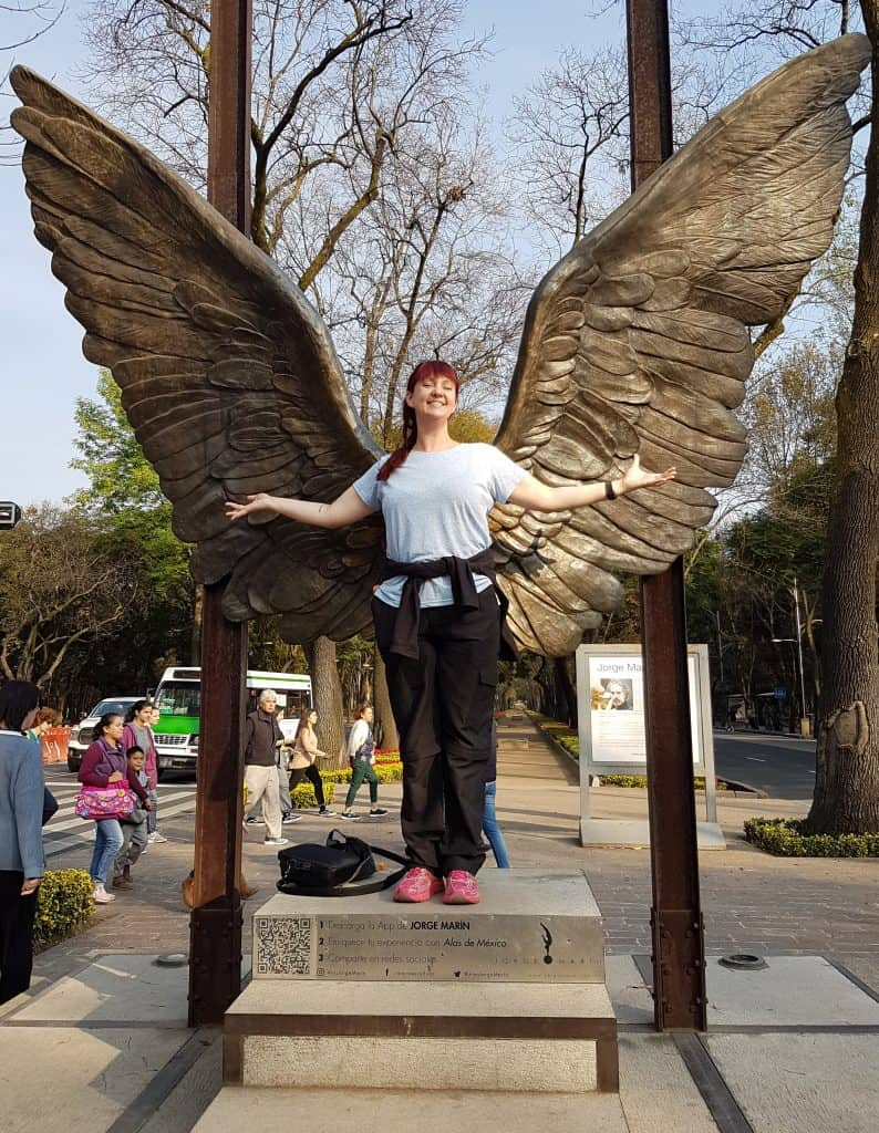 Author standing before Angel Wings in Mexico City