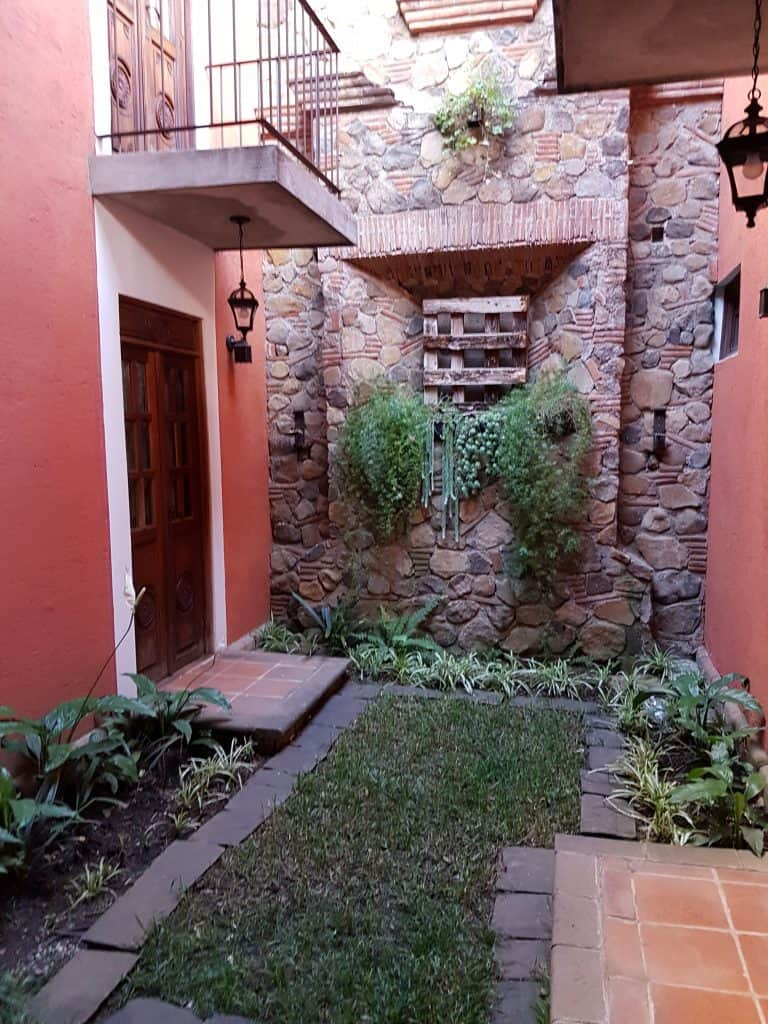 Smaller courtyard outside the downstairs rooms at Hotel Candelaria, Antigua Guatemala