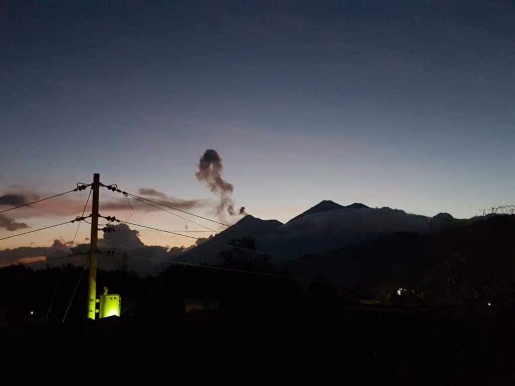 Watching Fuego erupting from the rooftop of Hotel Candelaria, Antigua Guatemala
