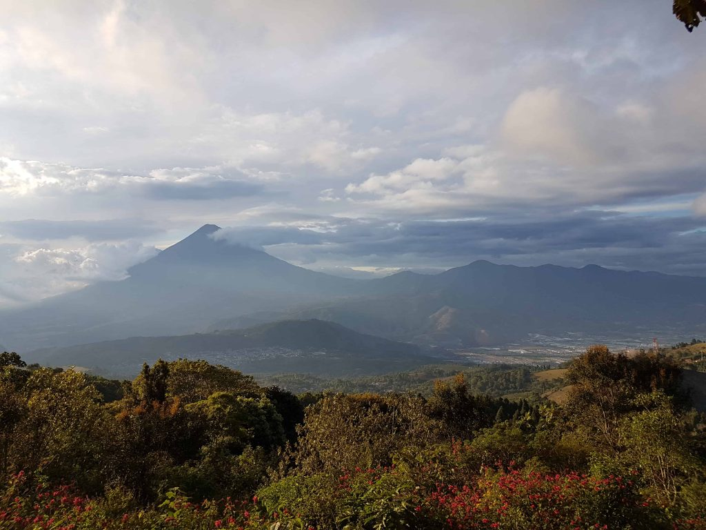 Image of Volcan Agua taken from the slopes of Volcan Pacaya in Guatemala. The top of Volcan Agua is shrouded in cloud