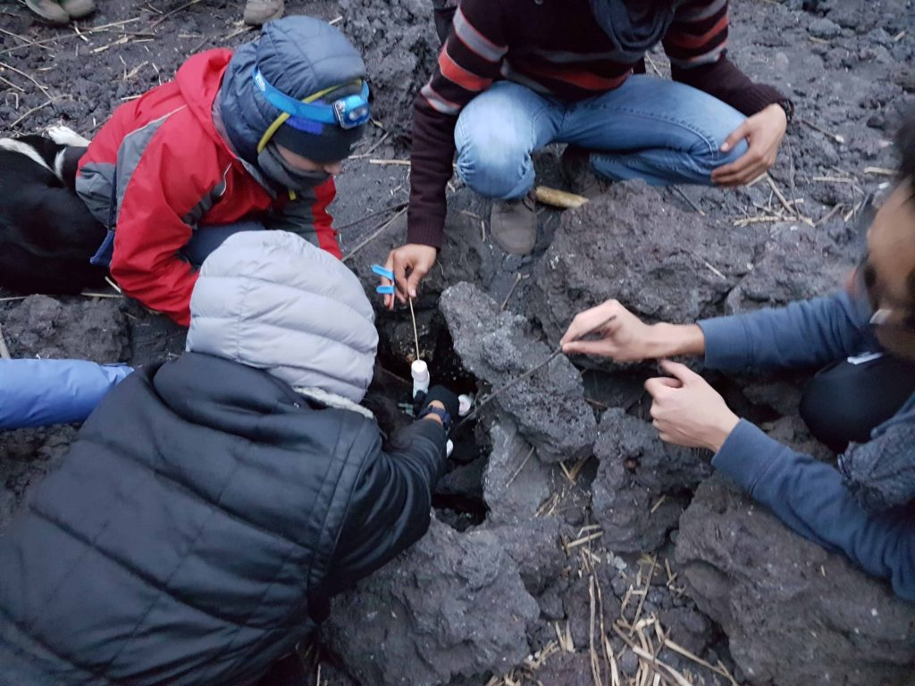 Toasting marshmallows in a fissure at the top of Volcan Pacaya in Guatemala