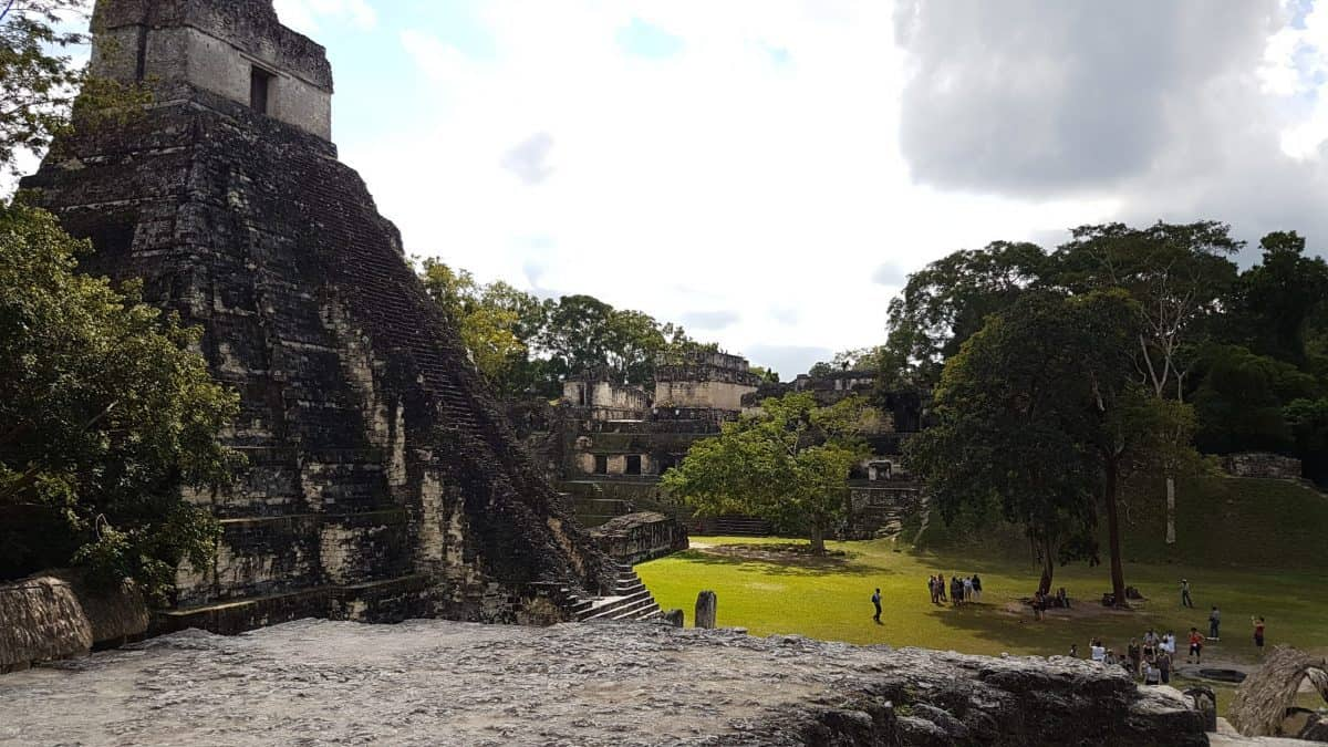 View from the North Acropolis of Tikal, several structures border the clearing in the centre of Great Plaza at the base