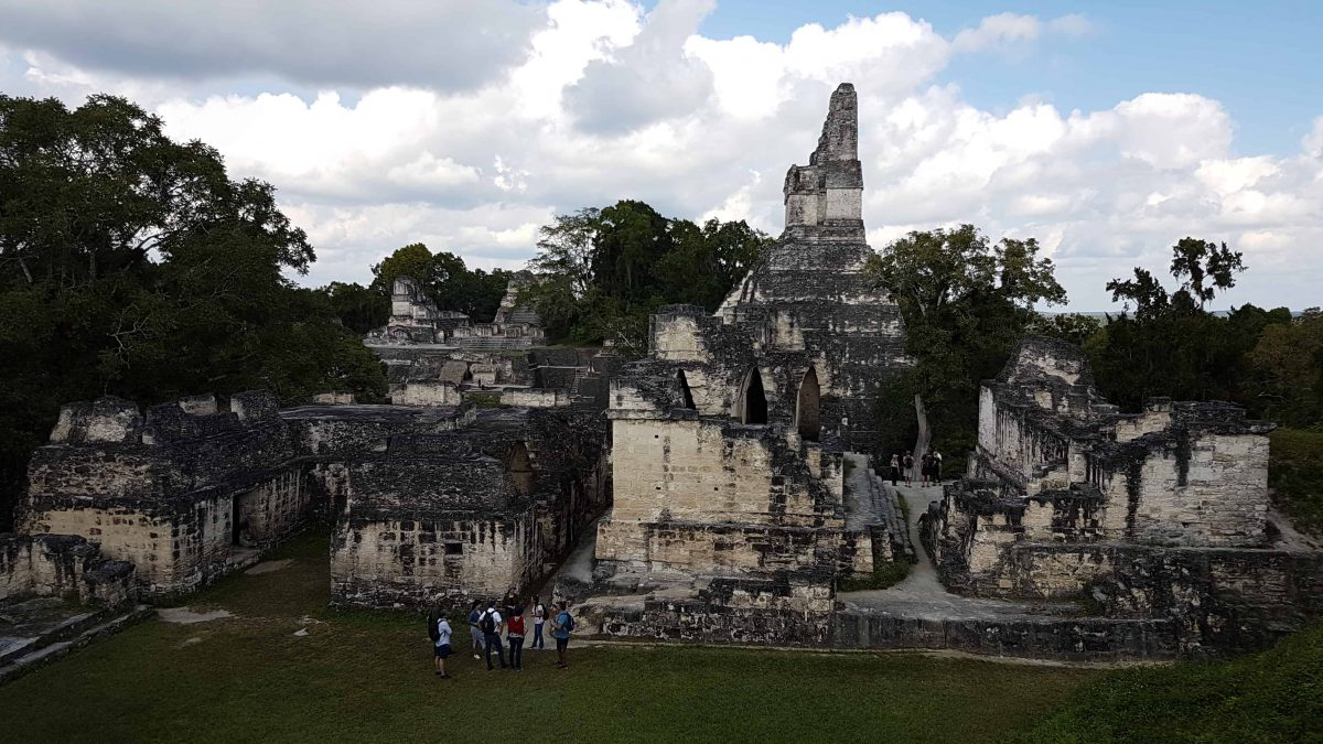 The Central Acropolis of Tikal was the residential part of the plaza. Taken from within the Central Acropolis, Temple I and the North Acopolis can be seen behind