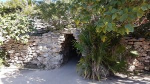 Passage through stone wall surrounding the city ruins at Tulum