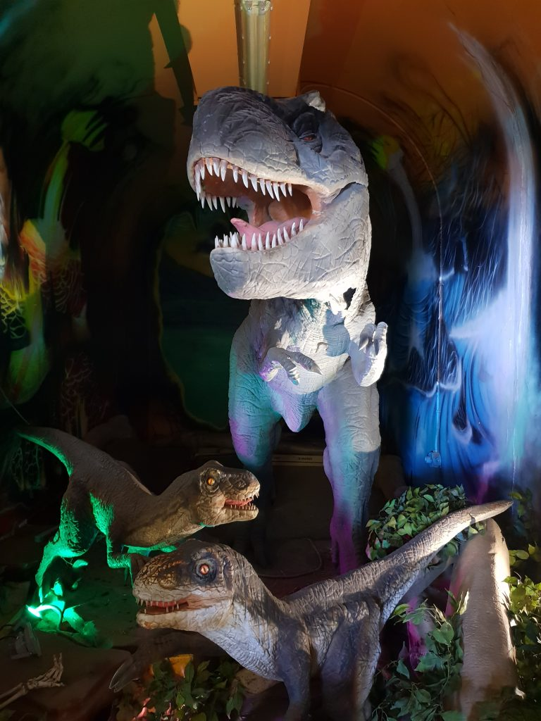 Velociraptors and Tyrannosaur display inside WW2 bunker Battery Cooper, Kualoa Ranch Oahu