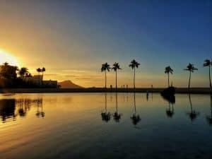 Reflection of sunrise on lagoon at Hilton Hawaiian Village