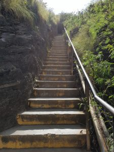 Set of stairs on Diamond Head hike leading to a tunnel through the rock