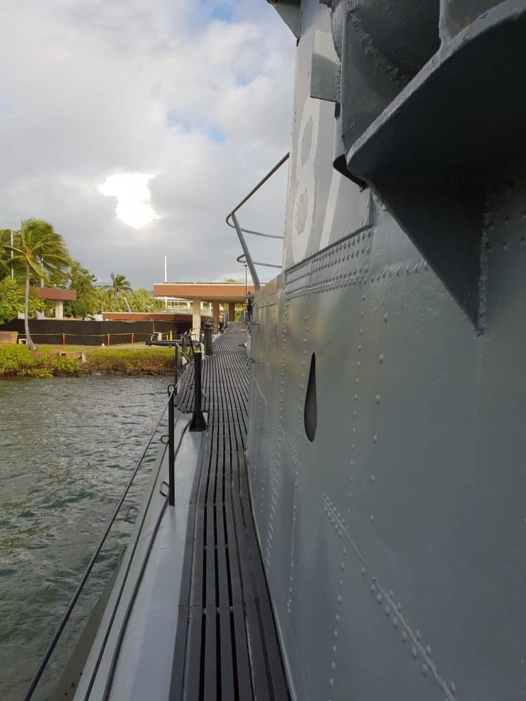 standing on the USS Bowfin, a decommissioned US Navy submarine now located at Pearl Harbor