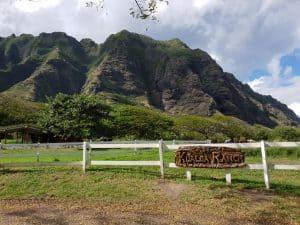 Jurassic Park Hawaii at Kualoa Ranch, Oahu. Engraved Kualoa Ranch sign against mountain backdrop