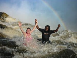 Fiona from Passport and Piano swimming in Angel's Pool, Victoria Falls Zambia with a local guide