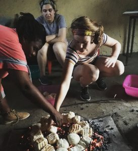 Learning to make the Zhosa bread by Lieve from Elundini Backpackers