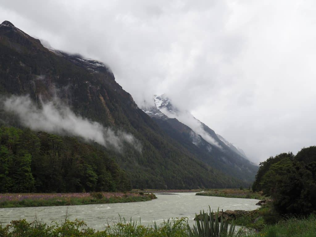 Mist and snow capped mountains on the journey down to Milford Sound
