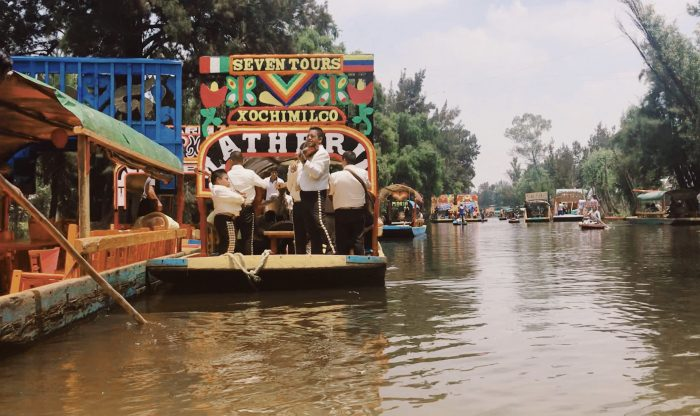 Mariachis on the canals at Xochimilco. Courtesy of Just Leaving Footprints