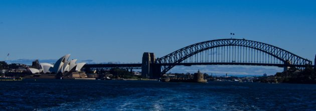 The Sydney Harbour Bridge and Opera House as seen heading out of Sydney Harbour