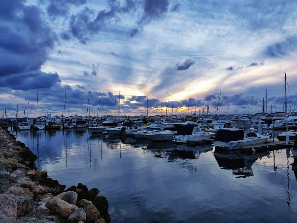 Sun sinking over the horizon from Hilary's Boat Harbour in Perth, Western Australia