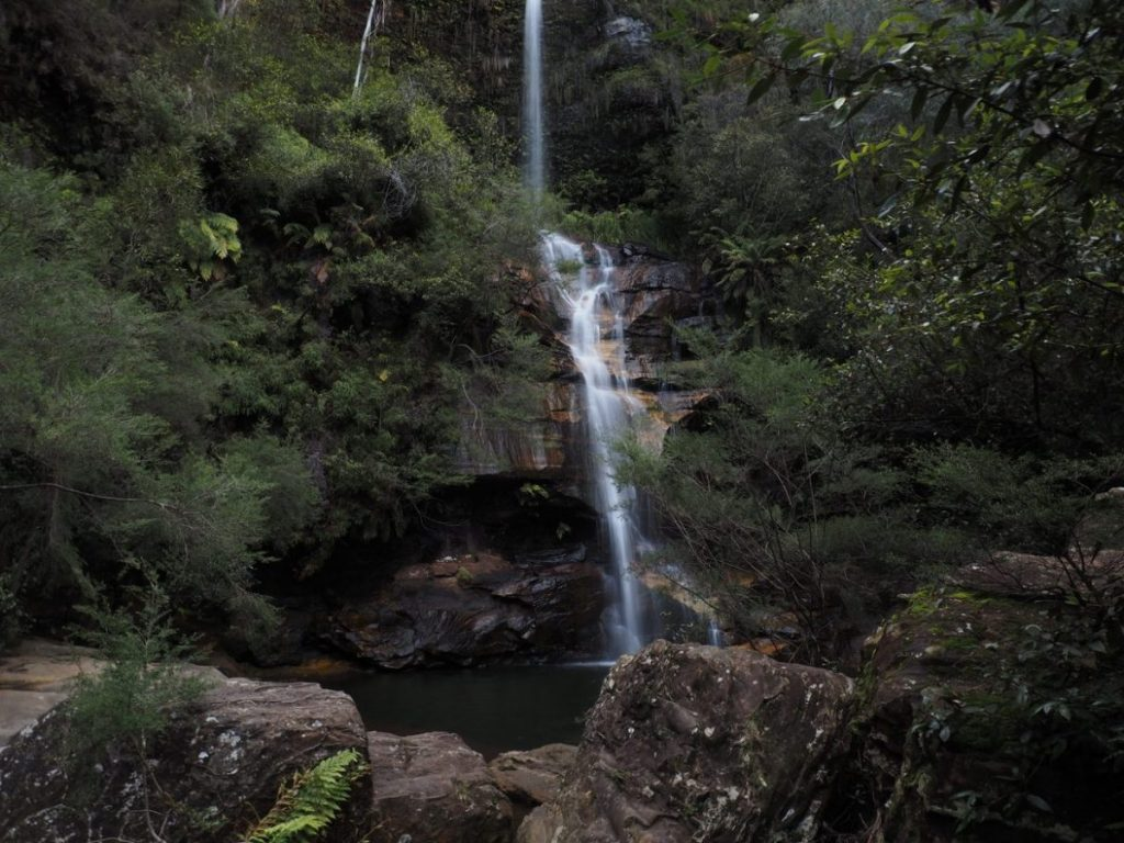Minni Ha Ha Falls in Katoomba, Blue Mountains. A large waterfall that falls into a deep swimming hole below