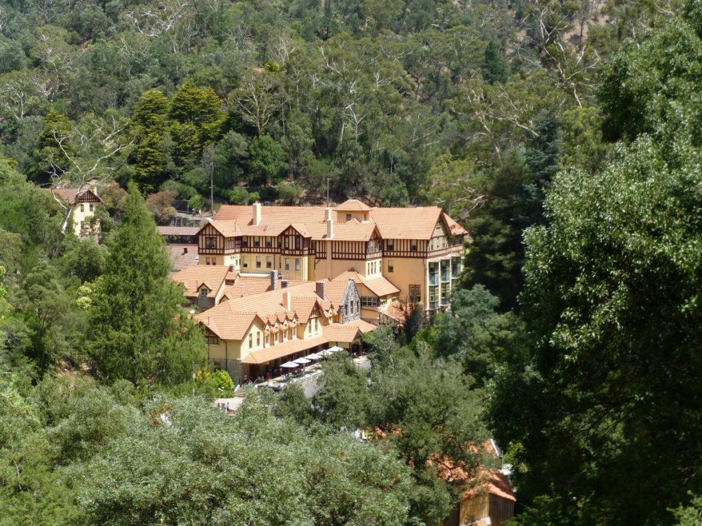 Jenolan Caves, a grand Victorian style building, as viewed from the path between the car park and the caves entrance.