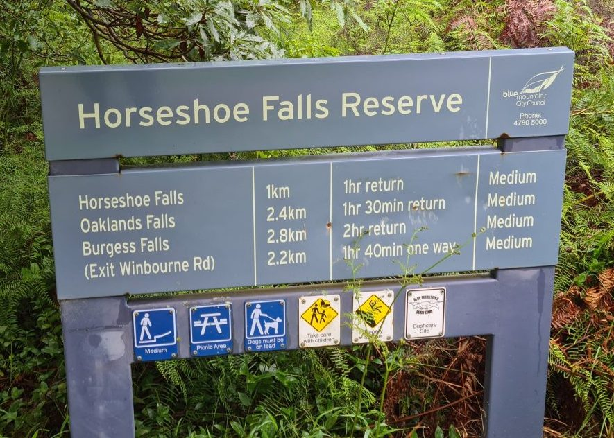 Sign at the entry point for Horseshoe Falls Hazelbrook, providing distance and time to each of the falls on the track