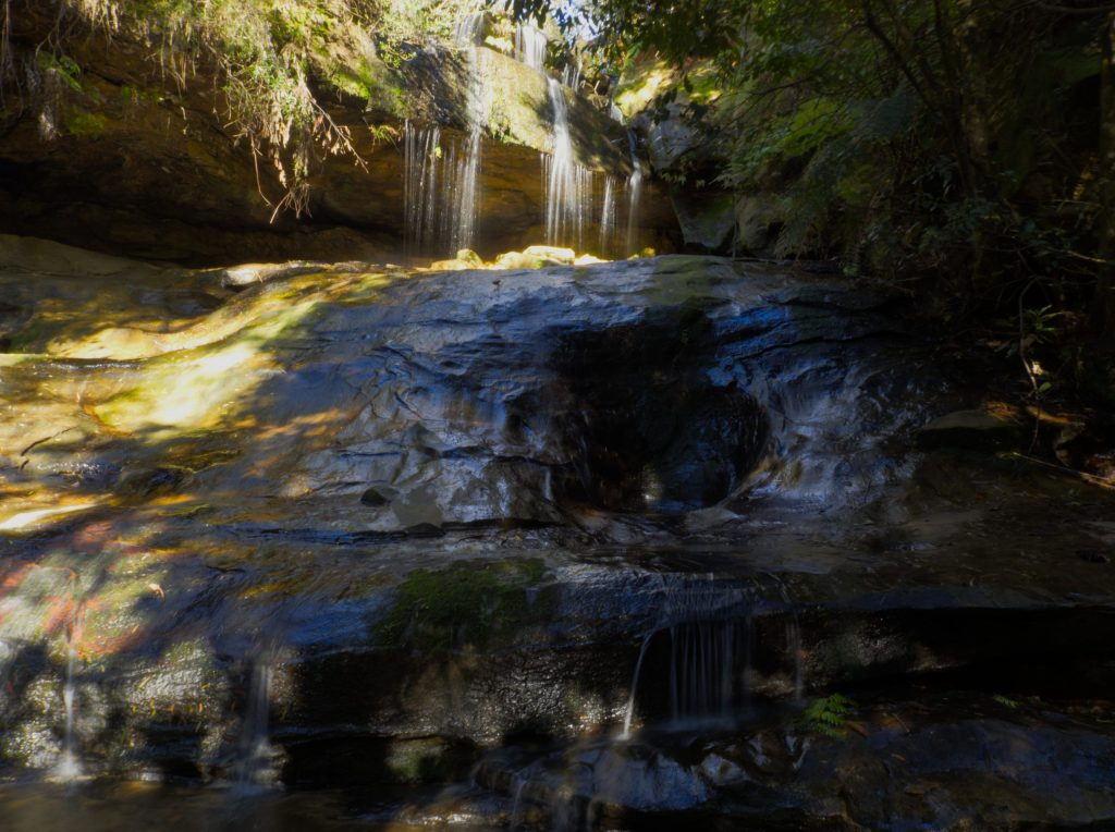 The first of the waterfalls aloong the Horseshoe Falls walking track is not signposted and no name has been identified. The water spills from the creek over a rock edge onto a larger rock below before falling into a small pool and continuing on into the gully