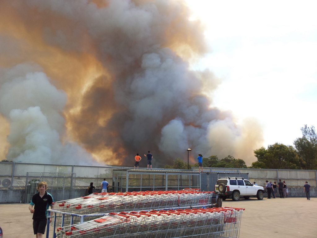 The October 2013 Linksview Fire burns behind the local Coles supermarket at Winmalee