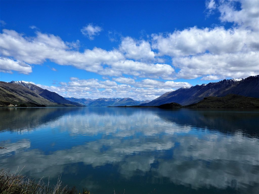 Clouds reflecting on the surface of Lake Wakatipu on the drive from Queenstown to Glenorchy